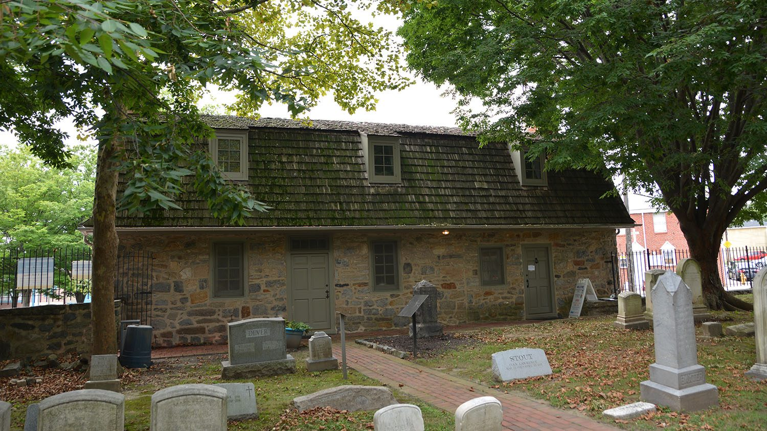 The Hendrickson House at Old Swedes viewed from the graveyard.